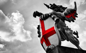 statue of st george from very low angle. greyscale bar the pop of red on the English flag